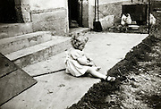little child playing by her self France vintage farm life