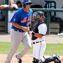 March 14, 2012; Lakeland, FL, USA; New York Mets first baseman Zach Lutz (65) scores on a bases loaded walk of Adam Loewen during the top of the third inning of a spring training game against the Detroit Tigers at Joker Marchant Stadium. Mandatory Credit: Derick E. Hingle-US PRESSWIRE