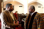 Derrick L. Foward, M.C.E., president of the Dayton Unit of the NAACP talks with Bishop Richard Cox, president of the Dayton Chapter of the SCLC following a service at the First Baptist Church of Dayton in downtown Dayton to 'honor the witness of the Rev. Dr. Martin Luther King, Jr., recalling his conviction that injustice anywhere is a threat to justice everywhere,' Sunday, January 15, 2012.