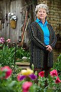 Bobbie Mason poses for a portrait in her backyard garden in Red Oak on Thursday, April 18, 2013. Mason's garden is one of the tour stops for the America Iris Society's national convention in Dallas. (Cooper Neill/The Dallas Morning News)