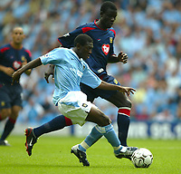 Photo Aidan Ellis.<br />Manchester City v Portsmouth.<br />FA Barclaycard Premiership.<br />23/08/2003.<br />City's Shaun Wright Phillips and Pompey's Andy Faye