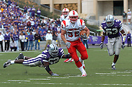 Louisville running back Brock Bolen (32) rushes past Kansas State linebacker Zach Diles (52) for a 17-yard touchdown in the fourth quarter, at Bill Snyder Family Stadium in Manhattan, Kansas, September 23, 2006.  The 8th ranked Louisville Cardinals beat K-State 24-6.