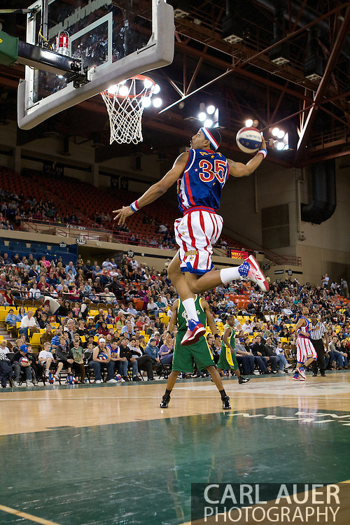 April 30th, 2010 - Anchorage, Alaska:  The Globetrotters start to pull away from the Washington Generals as Trotter Prince Perez (35) elevates for a spectacular windmill dunk.