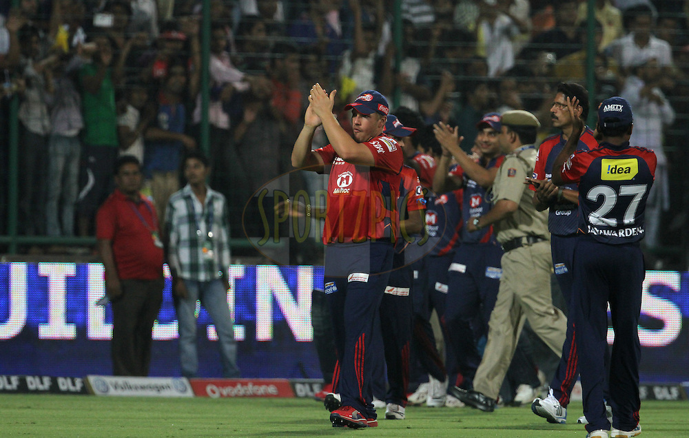 Delhi Daredevils players wave towards crowd after the match 67 of the Indian Premier League ( IPL) 2012  between The Delhi Daredevils and the Royal Challengers Bangalore held at the Feroz Shah Kotla, Delhi on the 17th May 2012..Photo by Vipin Pawar/IPL/SPORTZPICS