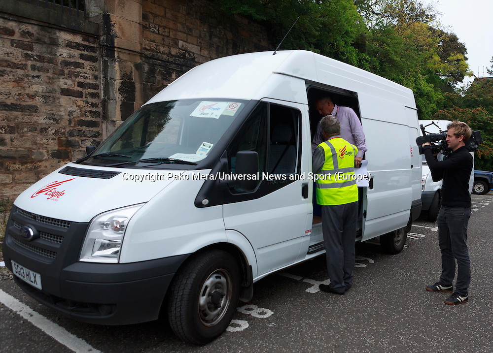 Video camera recording council workers.<br /> Ballot boxes delivered. Ballot boxes to be used for voting in the Scottish independence referendum will be picked up by van from storage for delivery to Edinburgh's 145 polling places. .<br /> Pako Mera/Universal News And Sport (Europe)17/09/2014