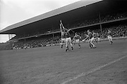 04/09/1966<br /> 09/04/1966<br /> 4 September 1966<br /> All-Ireland Minor Hurling Final: Cork v Wexford at Croke Park, Dublin.<br /> Wexford's M. Butler (13) and Cork's F. Norberg (4) jump for possession of the ball.