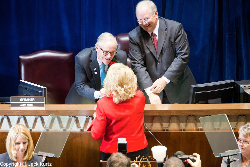 09 JANUARY 2012 - PHOENIX, AZ:   Governor Jan Brewer shakes hands with Sen Pres Steve Pierce and Speaker Andy Tobin before the Gov enters the chamber at the state legislature Monday. Gov Brewer delivered her State of the State inside while outside representatives of interest groups picketed and protested.   The Arizona legislature started its 2012 session and Gov. Jan Brewer delivered her State of the State Monday, Jan 9.                   PHOTO BY JACK KURTZ