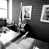 Benjamin Netanyahu sits behind the desk at his office in Tel Aviv, January 11, 2009.