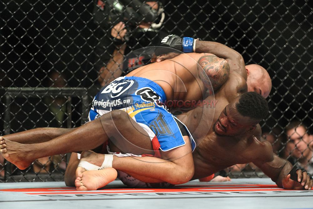 "BIRMINGHAM, ENGLAND, NOVEMBER 5, 2012: Thiago Alves (top) forces Papy Abedi to the canvas during ""UFC 138: Munoz vs. Leben"" inside the National Indoor Arena in Birmingham, United Kingdom"