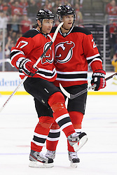 Jan 17; Newark, NJ, USA; New Jersey Devils defenseman Kurtis Foster (2) and New Jersey Devils left wing Ilya Kovalchuk (17) celebrate Kovalchuk's goal during the second period at the Prudential Center.