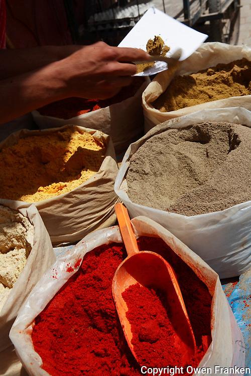 Spice merchant on the street in a Marrakech neighborhood
