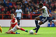 Nottingham Forest midfielder Ben Osborn (11) tackles Middlesbrough forward Adama Traore (37) during the EFL Sky Bet Championship match between Nottingham Forest and Middlesbrough at the City Ground, Nottingham, England on 19 August 2017. Photo by Jon Hobley.
