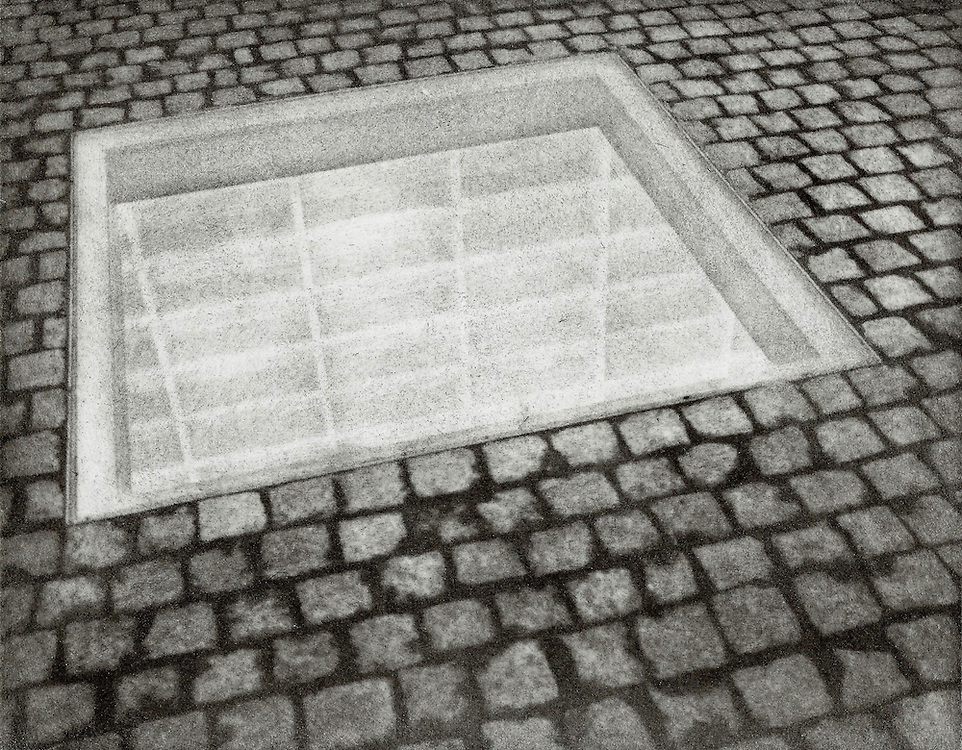 The Memorial to Burning Books in the Bebelplatz area of Berlin, Germany commemmorates the site where library books were piled up and burned in 1933. This image was created using the Bromoil process.