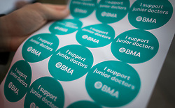 © Licensed to London News Pictures. 09/03/2016. London, UK.  Stickers in support of junior doctors are handed out on a picket at St George's hospital in Tooting. Junior doctors are continuing their strike action after the government said it intended to impose a new employment contract. Photo credit: Peter Macdiarmid/LNP