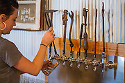 Darah Martin pours a beer at Bentonville Brewing Company on Friday, February 19, 2016, in Bentonville, Arkansas. Beth Hall for the New York Times