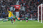 Marouane Chamakh beats the Southampton goalkeeper Fraser Forster to score his second goal during the The FA Cup match between Southampton and Crystal Palace at the St Mary's Stadium, Southampton, England on 24 January 2015. Photo by David Charbit.