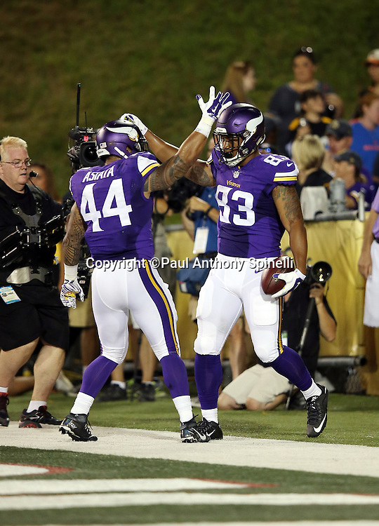 Minnesota Vikings rookie tight end MyCole Pruitt (83) celebrates with Minnesota Vikings running back Matt Asiata (44) after scoring a touchdown on a 34 pass and run play in the second quarter that gives the Vikings a 7-3 lead during the 2015 NFL Pro Football Hall of Fame preseason football game against the Pittsburgh Steelers on Sunday, Aug. 9, 2015 in Canton, Ohio. The Vikings won the game 14-3. (©Paul Anthony Spinelli)