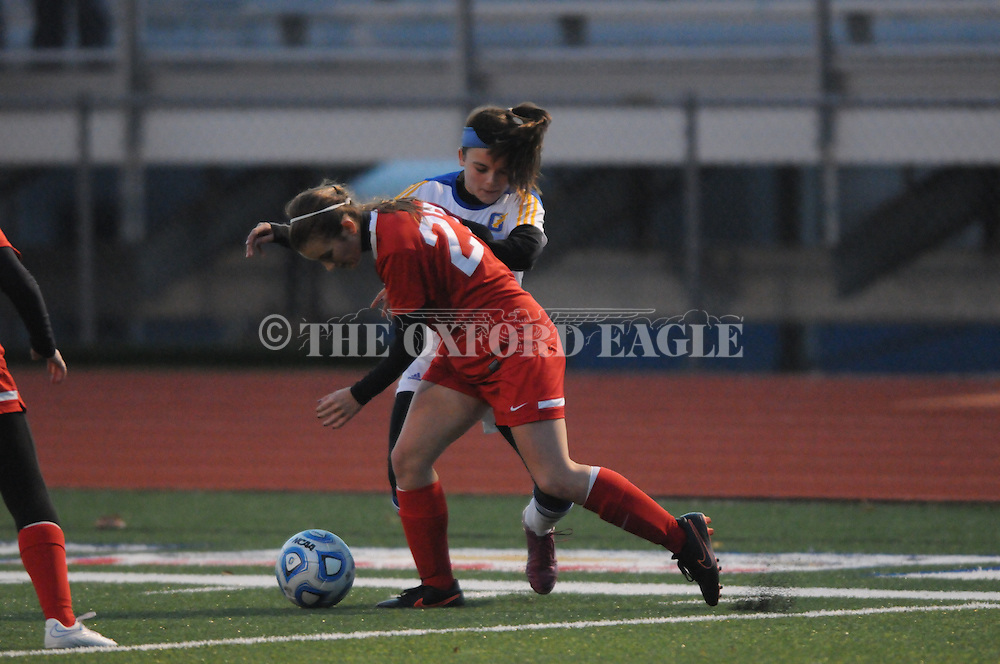 Oxford High's Morgan O'Connor (1) and Lafayette High's Rachel Watkins (27) battle for the ball in girls high school soccer, in Oxford, Miss. on Tuesday, December 9, 2014. Lafayette High won 3-2.