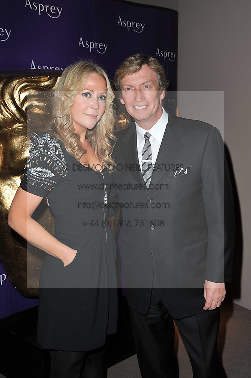 NIGEL LYTHGOE and SAMMY ? at the BAFTA Nominees party 2011 held at Asprey, 167 New Bond Street, London on 12th February 2011.