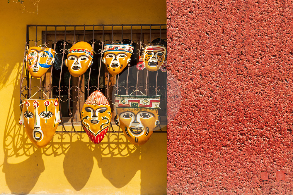 Colorful masks on sale at the pottery market in Dolores Hidalgo, Guanajuato, Mexico. The town is where Independence leader Miguel Hidalgo issued the now world famous Grito - a call to arms for Mexican independence from Spain.