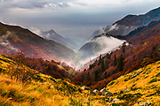 Splendid mountain landscape in autumn with rising fogs at morning