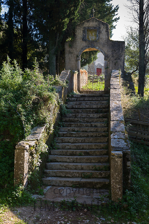 Stone stairs of St Nikolaos Petra Church form stairway to heaven in ancient village of Old Perithia - Palea Perithea, Corfu, , Greece