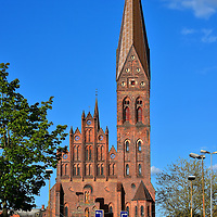 Spire of St. Alban's Church in Odense, Denmark <br /> This photo was taken along a long boulevard called Sankt Knuds Plads.  It shows the spectacular spire of St. Alban's Church which soars 177 feet in the center of Odense, Denmark.  It is sometimes confused with the St. Alban's Church were Canute IV of Denmark was killed in 1086.  That historic site was near here but no longer exists.  This St. Alban's Church was built in a neo-gothic style in 1908.