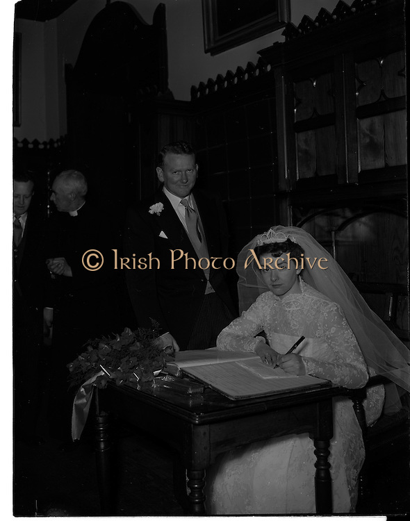 18/02/1957<br /> 02/18/1957<br /> 18 February 1957<br /> Wedding Dr K. Murphy and J. Fitzgerald at St. Mary's Church, Haddington Road and reception at Salthill Hotel, Monkstown. Bride and Groom signing the register.