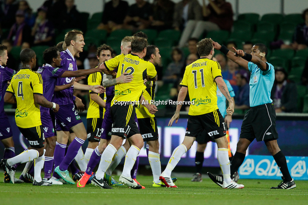 21.11.2014 Perth, Australia. Hyundai A League round 7, Perth Glory versus Wellington Phoenix. Referee Lucien Laverdure tries to regain control after tempers flared during the second half.
