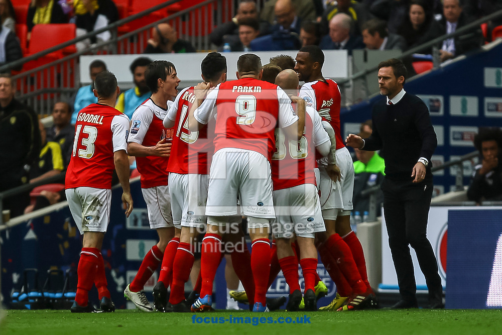 Antoni Sarcevic of Fleetwood Town celebrates with teammates and Fleetwood Town manager Graham Alexander after scoring his side's first goal during the Sky Bet League 2 match at Wembley Stadium, London<br /> Picture by Daniel Chesterton/Focus Images Ltd +44 7966 018899<br /> 26/05/2014