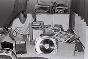 Teenagers looking through records in bedroom, London, UK, 1983