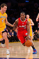 25 February 2011: Guard Eric Bledsoe of the Los Angeles Clippers drives to the basket while being guarded by Luke Walton of the Los Angeles Lakers during the first half of the Lakers 108-95 victory over the Clippers at the STAPLES Center in Los Angeles, CA.