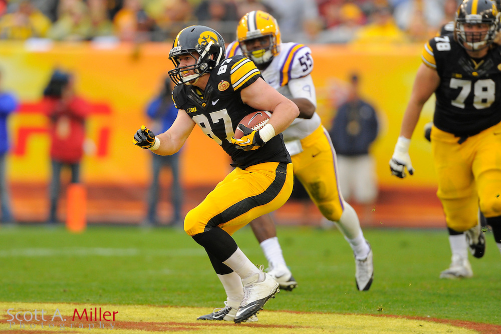 Iowa Hawkeyes tight end Jake Duzey (87) runs upfield after a catch against LSU in the 2014 Outback Bowl at Raymond James Stadium on Jan. 1, 2014 in Tampa, Florida. <br /> <br /> &copy;2014 Scott A. Miller