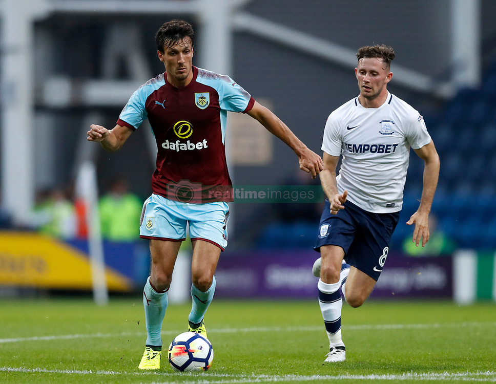 "Burnley's Jack Cork is chased down by Preston North End's Alan Browne during the pre-season friendly match at Deepdale, Preston. PRESS ASSOCIATION Photo. Picture date: Tuesday July 25, 2017. See PA story SOCCER Preston. Photo credit should read: Martin Rickett/PA Wire. RESTRICTIONS: EDITORIAL USE ONLY No use with unauthorised audio, video, data, fixture lists, club/league logos or ""live"" services. Online in-match use limited to 75 images, no video emulation. No use in betting, games or single club/league/player publications."