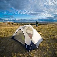 tent and man on ridge over looking prairie in eastern montana near ekalaka montana