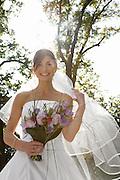 Mid-adult bride holding bouquet