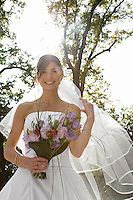 Mid-adult bride holding bouquet