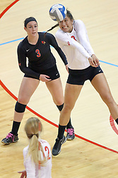17 October 2014:  Stacey Niao sets the ball in front of libero Emily Orrick during an NCAA Missouri Valley Conference (MVC) womens volleyball match between the Northern Iowa Panthers and the Illinois State Redbirds for 1st place in the conference at Redbird Arena in Normal IL