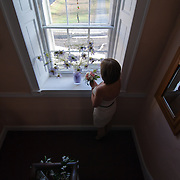 11/11/11 Elkton MD: Lelia Vavala of Wilmington Delaware gazes out the window before her wedding ceremony Friday, Nov. 11, 2011 at Elkton Wedding Chapel in Elkton Maryland.<br /> <br /> Special to The News Journal/SAQUAN STIMPSON