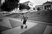 America, Cuba, Havana.  One boy plays football in the patio of the University. -05.07.2008, DIGITAL PHOTO, 49MB, copyright: Alex Espinosa/Gruppe28.