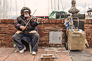 Elderly man (60+) busking with an electric Violin, Naples, Italy