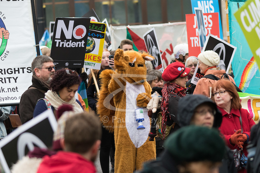 """London, February 27th 2016. A """"squirrel"""" raises moey for charity during CND's march and rally opposing the UK's Trident nuclear weapons programme. <br /> ©Paul Davey<br /> FOR LICENCING CONTACT: Paul Davey +44 (0) 7966 016 296 paul@pauldaveycreative.co.uk"""
