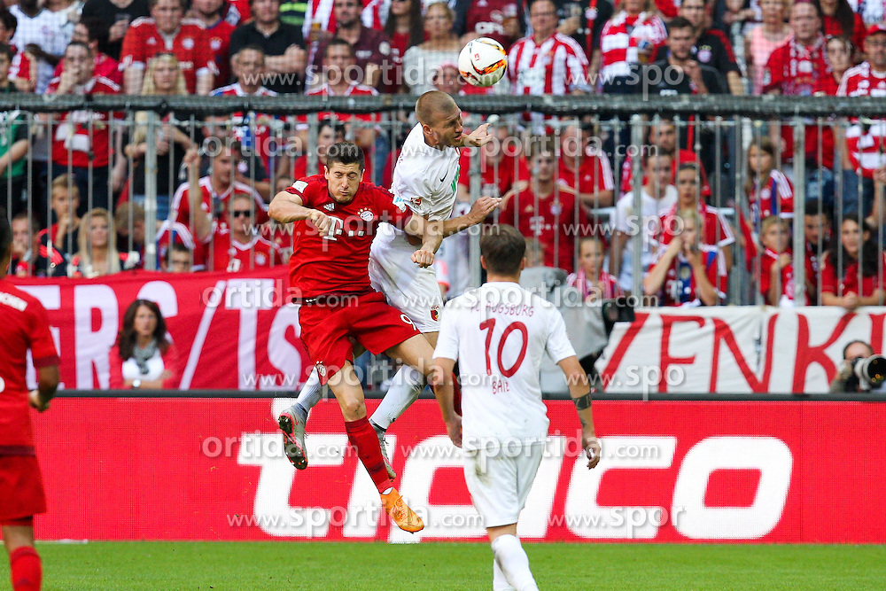 12.09.2015, Allianz Arena, Muenchen, GER, 1. FBL, FC Bayern Muenchen vs FC Augsburg, 4. Runde, im Bild l-r: im Zweikampf, Aktion, Kopfballduell mit Robert Lewandowski #9 (FC Bayern Muenchen) und Ragnar Klavan #5 (FC Augsburg) // during the German Bundesliga 4th round match between FC Bayern Munich and FC Augsburg at the Allianz Arena in Muenchen, Germany on 2015/09/12. EXPA Pictures &copy; 2015, PhotoCredit: EXPA/ Eibner-Pressefoto/ Kolbert<br /> <br /> *****ATTENTION - OUT of GER*****