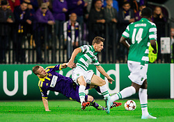 Dare Vrsic of Maribor vs Adrien Silva of Sporting during football match between NK Maribor and Sporting Lisbon (POR) in Group G of Group Stage of UEFA Champions League 2014/15, on September 17, 2014 in Stadium Ljudski vrt, Maribor, Slovenia. Photo by Vid Ponikvar  / Sportida.com