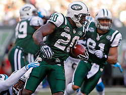 Nov 29, 2009; East Rutherford, NJ, USA; New York Jets running back Thomas Jones (20) runs with the ball during the first half at Giants Stadium.