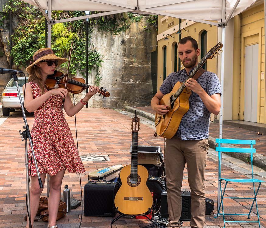 Sydney, Australia -- February 18, 2018. Street musicians playing in The Rocks area of Sydney on a Sunday afternoon. Editorial use only.