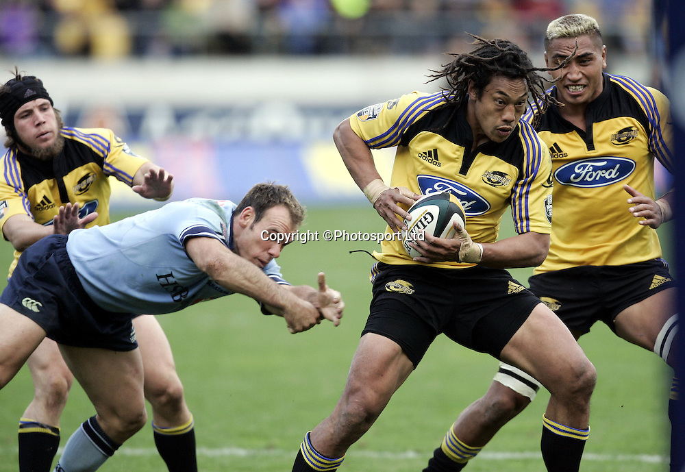 The Hurricanes Tana Umaga attacking during the Super 12 rugby union match against the Waratahs at Westpac Stadium, Wellington, New Zealand on Sunday 10 April, 2005. The Hurricanes won the match 26-24. Photo: Anthony Phelps/PHOTOSPORT