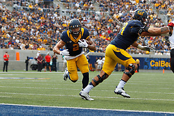 BERKELEY, CA - SEPTEMBER 12:  Running back Daniel Lasco #2 of the California Golden Bears scores a touchdown against the San Diego State Aztecs during the third quarter at California Memorial Stadium on September 12, 2015 in Berkeley, California. The California Golden Bears defeated the San Diego State Aztecs 35-7. (Photo by Jason O. Watson/Getty Images) *** Local Caption *** Daniel Lasco