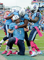 Tennessee Titans quarterback Ryan Fitzpatrick gets congratulated by Kenny Britt and Chris Johnson after scoring a touchdown against the Kansas City Chiefs at LP Field on October 6, 2013 in Nashville, TN. Photos by Donn Jones Photography.