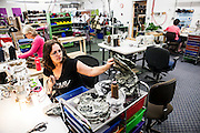 DEXTER, ME - AUGUST 4, 2015:  Becky Joslyn (46), an employee at Erda Handbags, works assembling bags at the company's production facility in Dexter, Maine. Since most of Erda's employees are 60 years or older they have implemented a flexible scheduling system and invested in more ergonomic machines to accommodate their aging workforce. <br /> Craig Dilger for The New York Times
